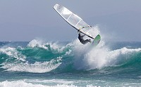windsurfer surfing a wave.