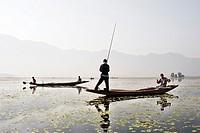 Fishermen on Dal Lake.