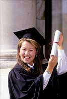 Korean woman holding diploma celebrates graduation from university, Canada, Ontario