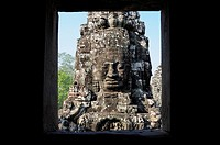 Enigmatic Lokesvara stone faces on the towers of the Bayon temple, Angkor Thom. Cambodia, Siem Reap, Angkor.