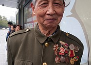 Elderly eccentic in Chengdu shows off his collection of Mao-era medals and badges.