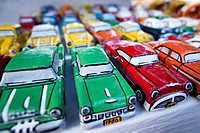 Painted papier mache model cars on the open air market, Trinidad, Sancti Spíritus Province, Cuba, Central America.
