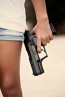 Girl holding a gun.
