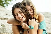 Teenage friends hugging. Valencia, Spain