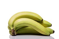 Bunch of bananas on white background close-up.