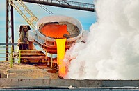 hot steel pouring in steel plant. Production of cast iron in steel mills.