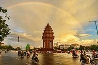 Independence Monument (Vimean Akareach) under a rainbow, Phnom Penh, Cambodia.
