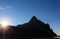 Sun on skyline of Anayet peak. Pyrenees. Hesca province. Aragon. Spain.