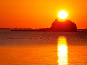 Sunrise behind St.John's Tower ruins at Alfacs Bay. Ebro River Delta Natural Park, Tarragona province, Catalonia, Spain.