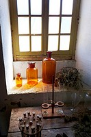 18th century, glass storage jars in the kitchen window of the Abbaye-Chateau Cassan, Roujan, France,