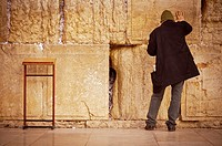 Praying at the Western Wall (Jerusalem).