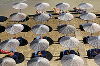 Aerial view of sun umbrellas, Beach of Georgioupoli on the north part of Crete, Greece.
