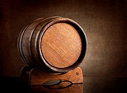 Old wooden barrel on a background of canvas.