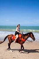 Horse riding on the beach, Cumbuco, Fortaleza district, Brazil.