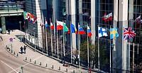 Flags waving at the European Parliament headquarters.