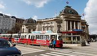Tram passing next to Volkstheatre in Vienna.