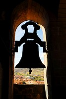 Silhouette of a small bell, Bell Tower in the cathedral of Siguenza, province of Guadalajara, Castilla La Mancha, Spain