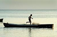 Fisherman preparing fishing net on a small boat near Farallon village, Cocle Province, Panama.