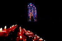 Candles and Harry Clarke Stained Glass, Dominican Black Friary, Kilkenny City, Ireland.