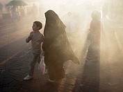 Smoke shrouded marketplace in Djemaa el-Fna square, (the main square) in the Medina in Marrakesch, Morrocco.