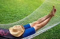 Adult male relaxing in a hammock.