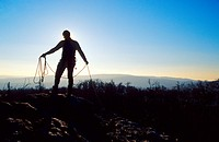 The silhouette of a climber packing his rope, Male Karpaty, Slovakia.