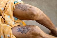 Typical tattoos on woman´s legs, Gond tribe, Gadchiroli, Maharashtra, India.