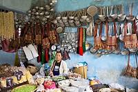 Lady selling vegetables and utensils. Bomdila bazaar, Arunachal Pradesh, India.