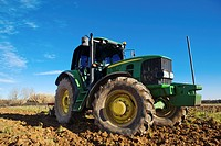 Farm tractor preparing the soil and ranking the field before plating, Montijo, Badajoz, Extremadura, Spain.