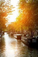 Netherlands. Amsterdam. Channel of Amsterdam at sunset.