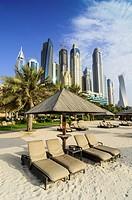 Skyscrapers of Dubai Marina tower above The Westin Dubai Mina Seyahi Beach Resort Hotel, Dubai, UAE.