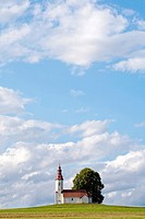 Scenery with clouds and church. Slovenia.
