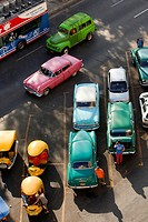 Old american cars and Coco Taxis parked at the street, Havana, Cuba, West Indies, Central America.