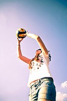 Girl playing volleyball.