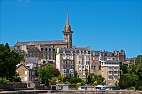 Promenade du Clair de Lune, along the sea, and church and church steeple, with granite typical houses, Dinard, Brittany, Ille et Villaine 35, France.