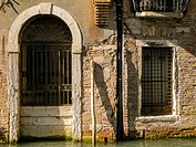 Architectonical detail of an old door and window. Venice. Veneto. Italy.
