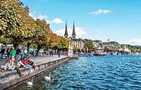Tourists and Locals at the Schweizerhofquai lakeshore of Lake Lucerne in Summer, Lucerne, Switzerland.