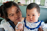 Mother and child aboard the train from Bangkok to Ayutthaya.