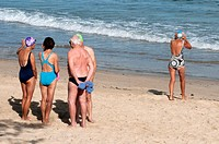 Going it alone: seniors on the beach at Mooloolaba, Sunshine Coast, Queensland, Australia