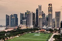 Singapore Downtown Core skyline overlooking The Padang sporting field.