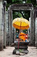 Buddha statue at the entrance of Bayon temple in Angkor Cambodia.