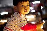 Cute Cambodian kid in a market in Siem Reap Cambodia.