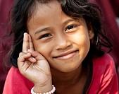 Young smiling Cambodian girl posing.