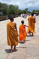 Group of monks exiting Angkor Wat temple in Cambodia.
