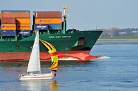 Container ship on the river Elbe near Grunendeich, Old Country, Altes Land, Stade, Lower Saxony, Germany