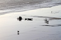 People walking on the Filey beach on a sunny winters day, Filey, North Yorkshire, England, UK,.