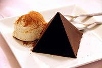 chocolate pyramid dessert with ice cream.