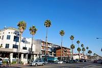 Restaurants, shops and pedestrains along palm tree-lined, trendy Ocean Avenue in Santa Monica, California, USA.