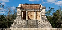 Ruined Mayan dais rises above the Juego de Pelota playing field at Chichen Itza, Yucatan, Mexico.