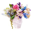 Bouquet from artificial flowers arrangement centerpiece in vase isolated on white background. Closeup.
